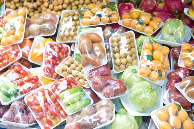 Assorted wrapped packages of various fruits and vegetables